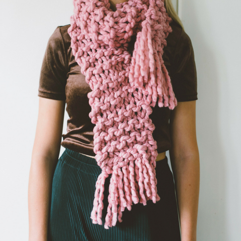 Chunky knit pink yarn scarf made in new Zealand using 2 ply xxl wool and giant knitting needles, shipping worldwide, plump and co also make giant woollen, merino blankets, ottomans, wall hangings, jumpers, bowls, slippers, plant holders, bags, pet beds, pillows and cushions
