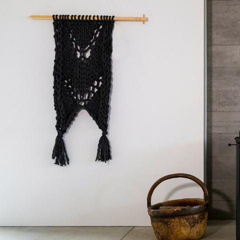 Knit your own beautiful chunky yarn wall hanging to add texture to your home.