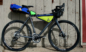 upshift frame bag colorful large multi-color green guru in use attached to bike bikepacking
