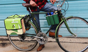 double dutch dual pannier everybike upcycled green guru colorado bike cargo mounted on townie bike in use
