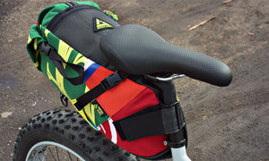 Hauler bike saddle bag green guru gear upcycled bikepacking lifestyle attached to seat post colorful