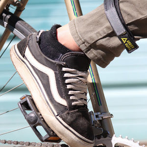 ankle strap for bicycling to keep pants out of chain lifestyle shot in use made from repurposed bike tubes green guru