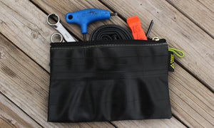 zipper pouch made from upcycled bike tubes in colorado by green guru gear grand size full of bike tools