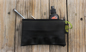 mid-size zipper pouch green guru upcycled filled with bike tools accessories