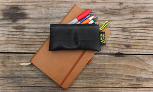 green guru small zipper pouch holding pens and pencils lifestyle sustainable recycled upcycled