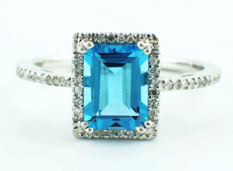 1.70ct Emerald Cut Blue Topaz with .11ct Diamond Halo