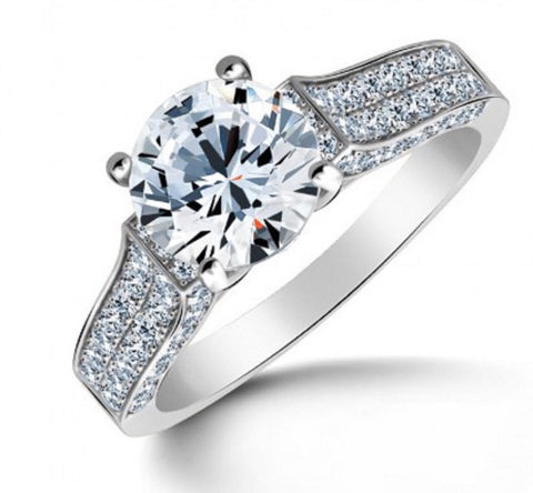 2ct Round Brilliant Solitaire with pave set in Rhodium plated Sterling.