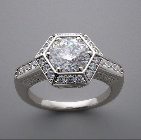 Vintage inspired Art Deco Hexagon Halo Engagement Ring. Lab created diamonds set in sterling silver.