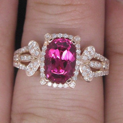 1.14ct Faceted Oval Pink Sapphire and Diamond Ring.