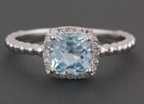 Cushion Cut Blue Topaz and Diamond Halo Engagement Ring in 14k White Gold