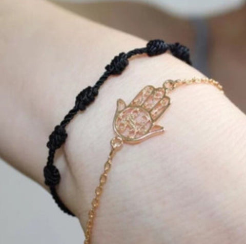 Hamsa hand bracelet in 18k rose gold plating.