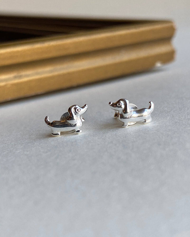pretty vacant sausage dog stud earrings