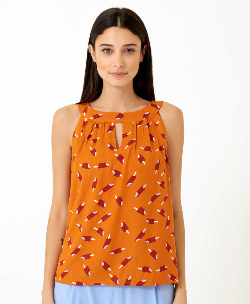 pretty vacant connie top - orange top with ice lollys and cutaway shoulders - front