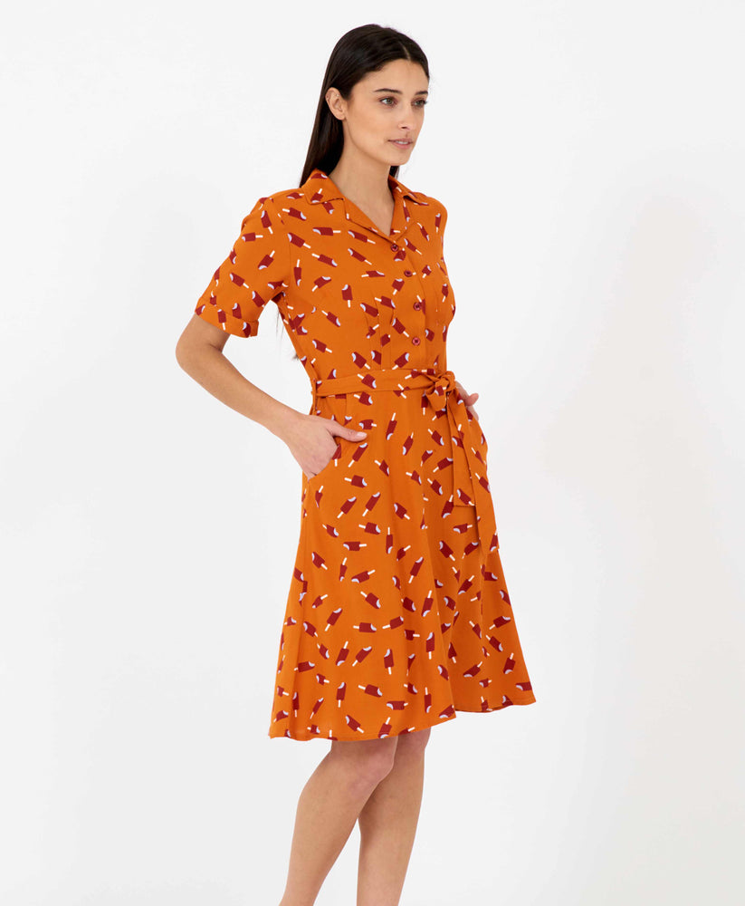 Pretty Vacant Kim Dress - burnt orange shirt dress with ice lolly print, midi length - side with pockets