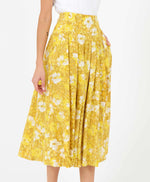 pretty vacant sarah midi skirt in a mustard yellow sunny floral print - side
