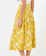 pretty vacant sarah midi skirt in a mustard yellow sunny floral print - back