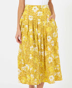 pretty vacant sarah midi skirt in a mustard yellow sunny floral print