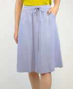 pretty vacant tina powdered blue midi skirt