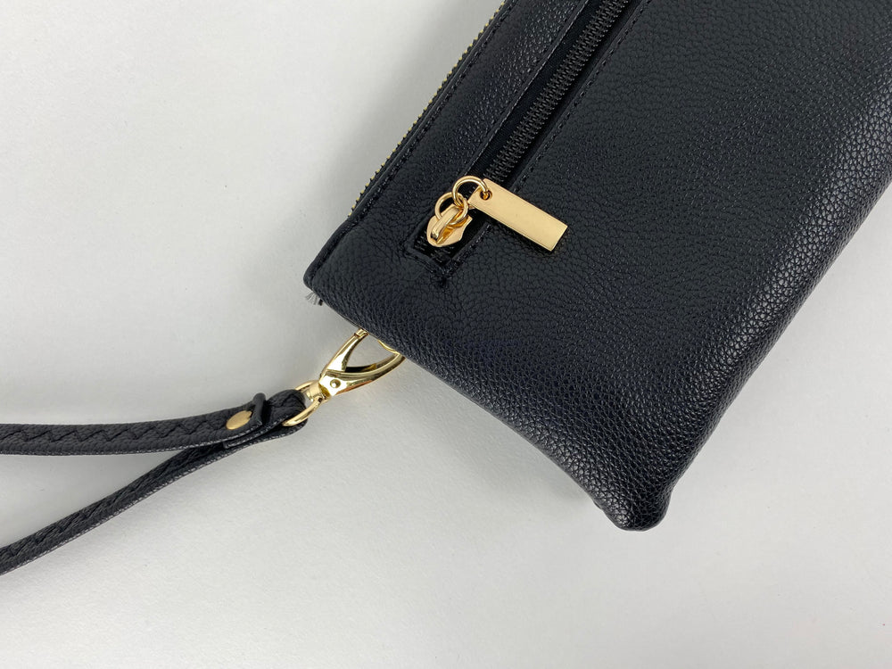 Pretty Vacant small black clutch bag in faux leather and gold zip closeup