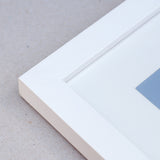 Close up image of 20mm matt white wooden frame