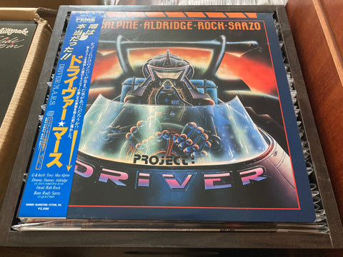 MacAlpine-Aldridge-Rock-Sarzo - Project: Driver CW/OBI LP 33⅓rpm (Out Of Print) (Graded: NM/NM)