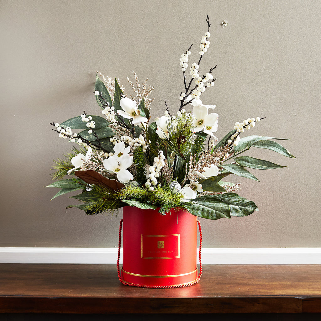 White Velvet Dogwood, Ilex Berry with Magnolia & Eucalyptus Leaves Christmas Hat Box Floral Arrangement