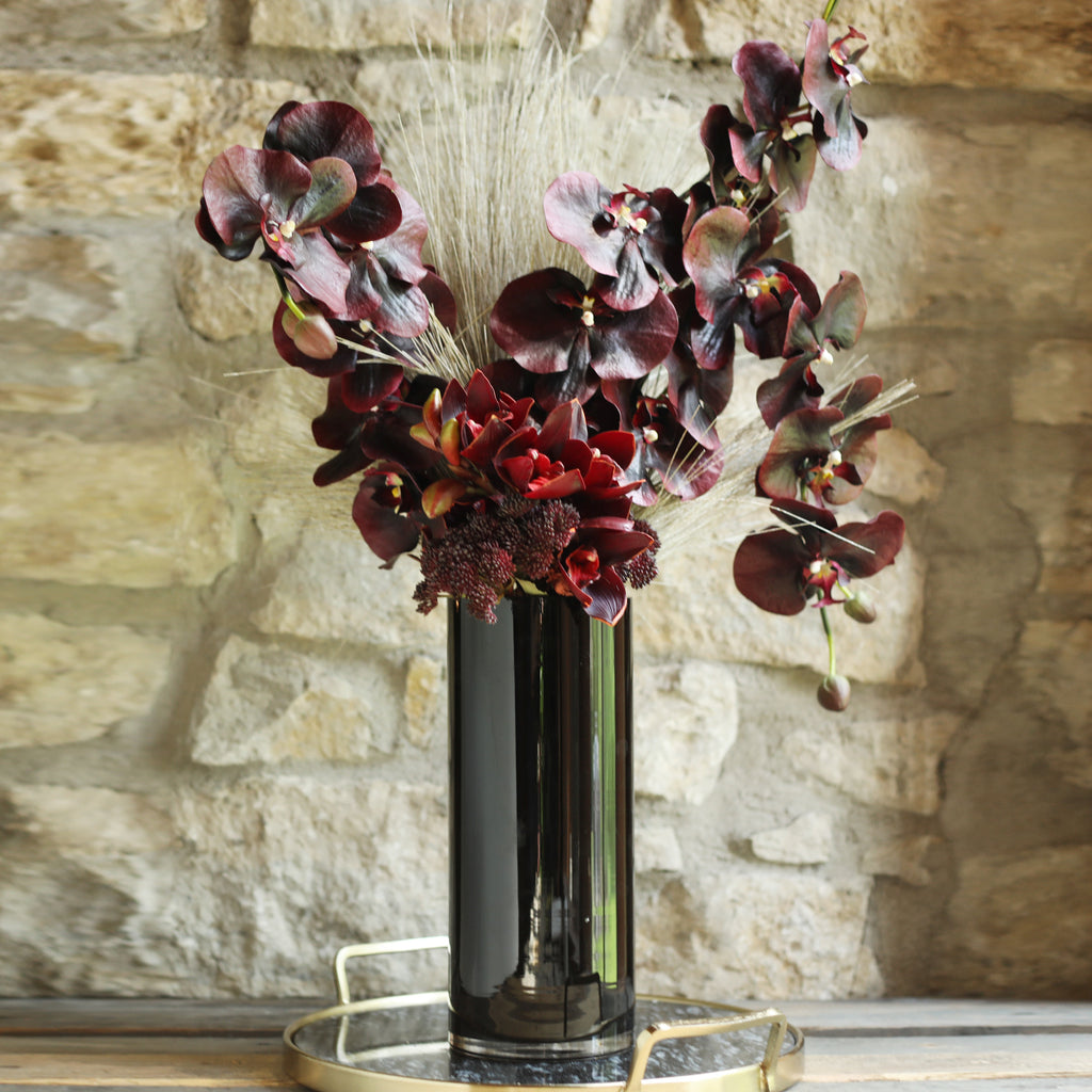 Large Real Touch Burgundy Orchid, Sedum & Dried Look Grass Floral Arrangement in Black Glass Vase