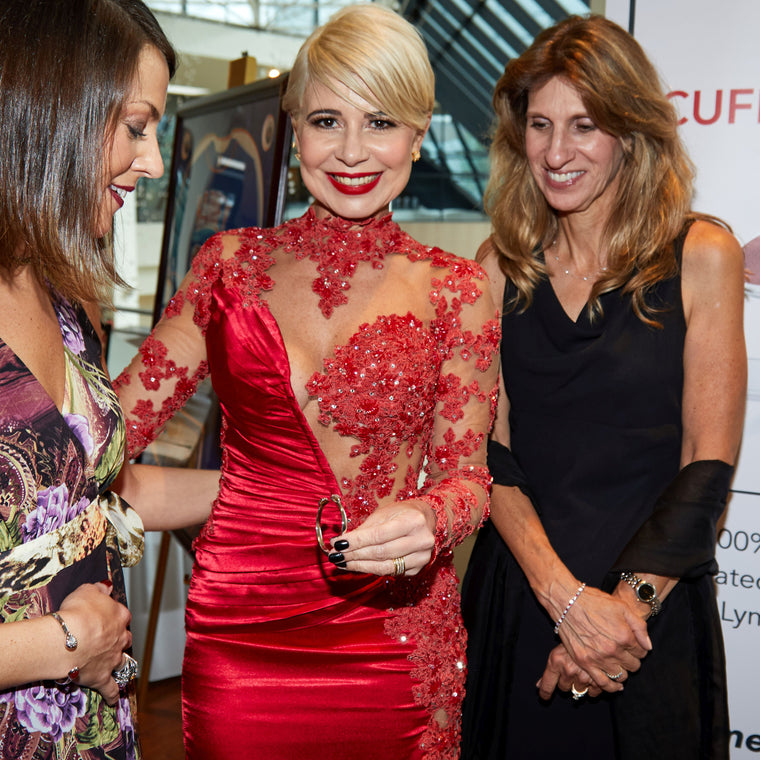 Designer Cristina Sabatini Holding Charity Cuff for a Cure Bracelet at LLS Gala