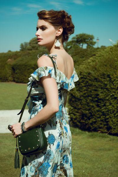 Model Wearing Indra Crossbody - Black Pebble Leather Handbag by Cristina Sabatini