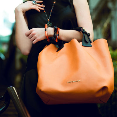 Model Wearing Kristen Tote - Tiger Orange Leather Handbag by Cristina Sabatini