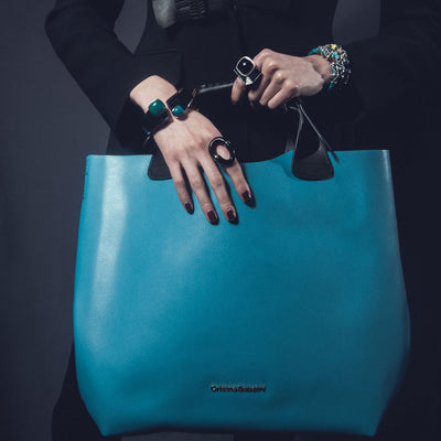 Model Wearing Kristen Tote - Caribbean Blue Leather Handbag By Cristina Sabatini