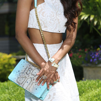 Close up of a model wearing Serena Crossbody - Aqua Python Snakeskin Leather Handbag by Cristina Sabatini