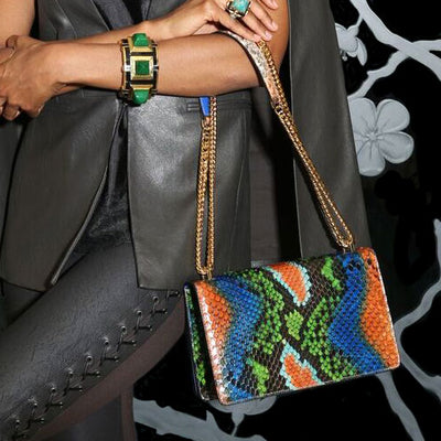 Model Wearing Serena Crossbody - Bold Rainbow Snakeskin Python Leather Handbag by Cristina Sabatini