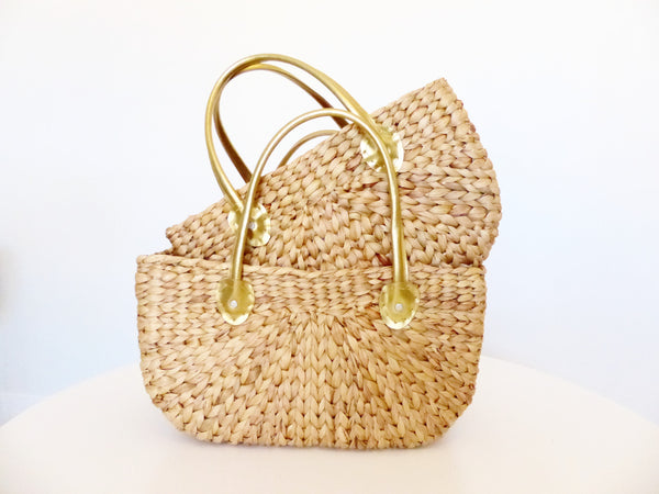 Water hyacinth market bags with a gold handle, shown in Large and Small. By Robert gordon Australia