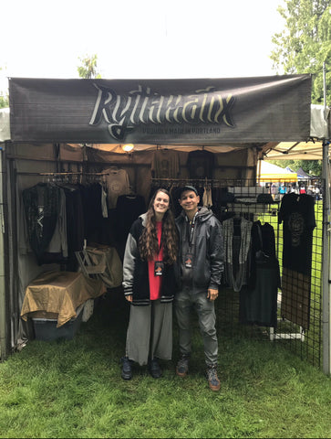 Bryn and Chris stand proudly in front of the Rythmatix booth at DFO in 2018.