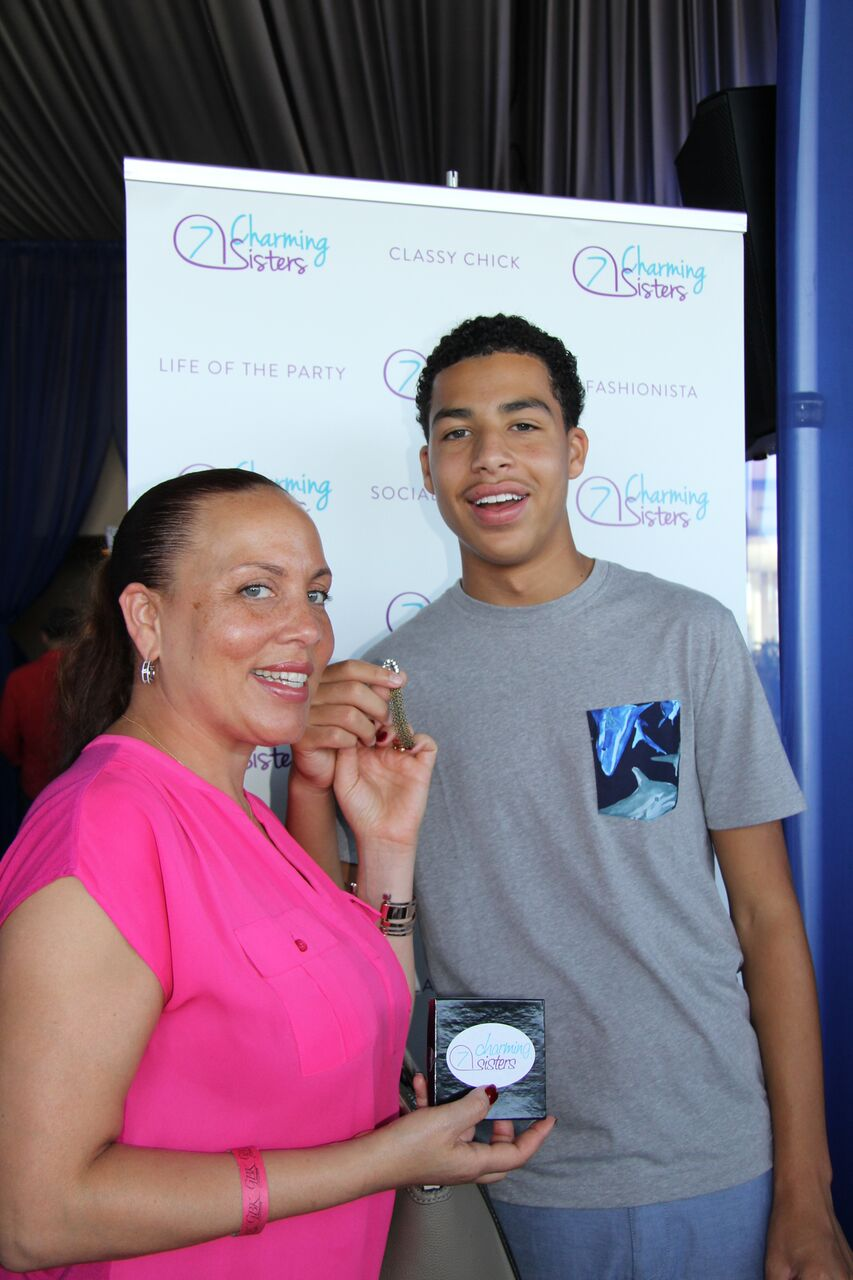 Marcus Scribner and Mom from Black-ish with 7 Charming Sisters jewelry company at 2016 Emmys