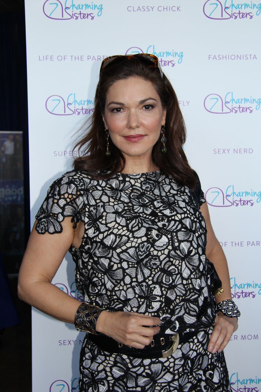 Laura Harring from NCIS: Los Angeles with 7 Charming Sisters jewelry company at 2016 Emmys