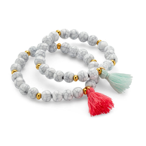 White whispers stackable bracelet with Tassel pendants