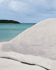 Affina Hexo Matelassé Coverlet on beach in Vieques