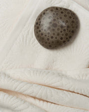 Close-up of Affina Hexo Organic Towels with Petoskey Stone
