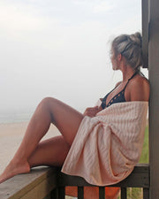 Girl wrapped in Affina Sand Ripple Towel