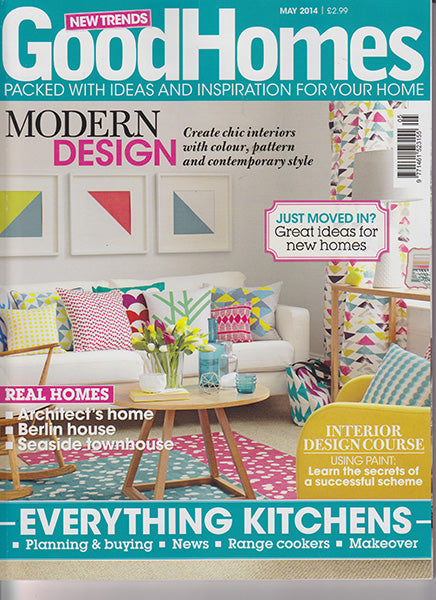 étoile home's London polka dot, Bunting and Huts tiki pattern throw pillows on the cover of Good Homes Magazine.
