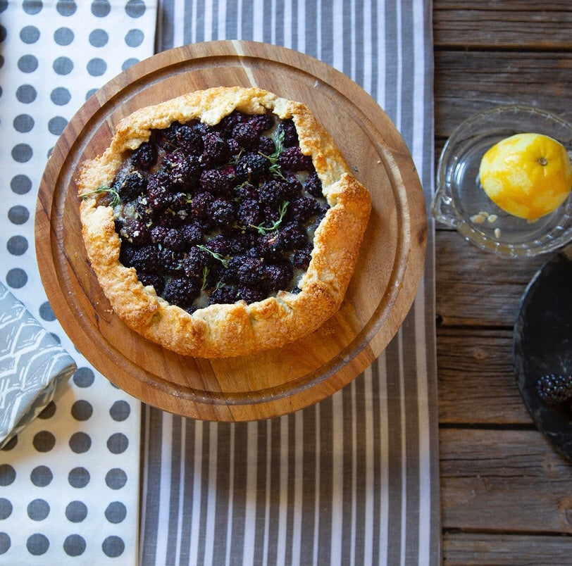 Blackberry and thyme tart recipe with grey striped and spotty tablecloths and wave fabric ships from Canada