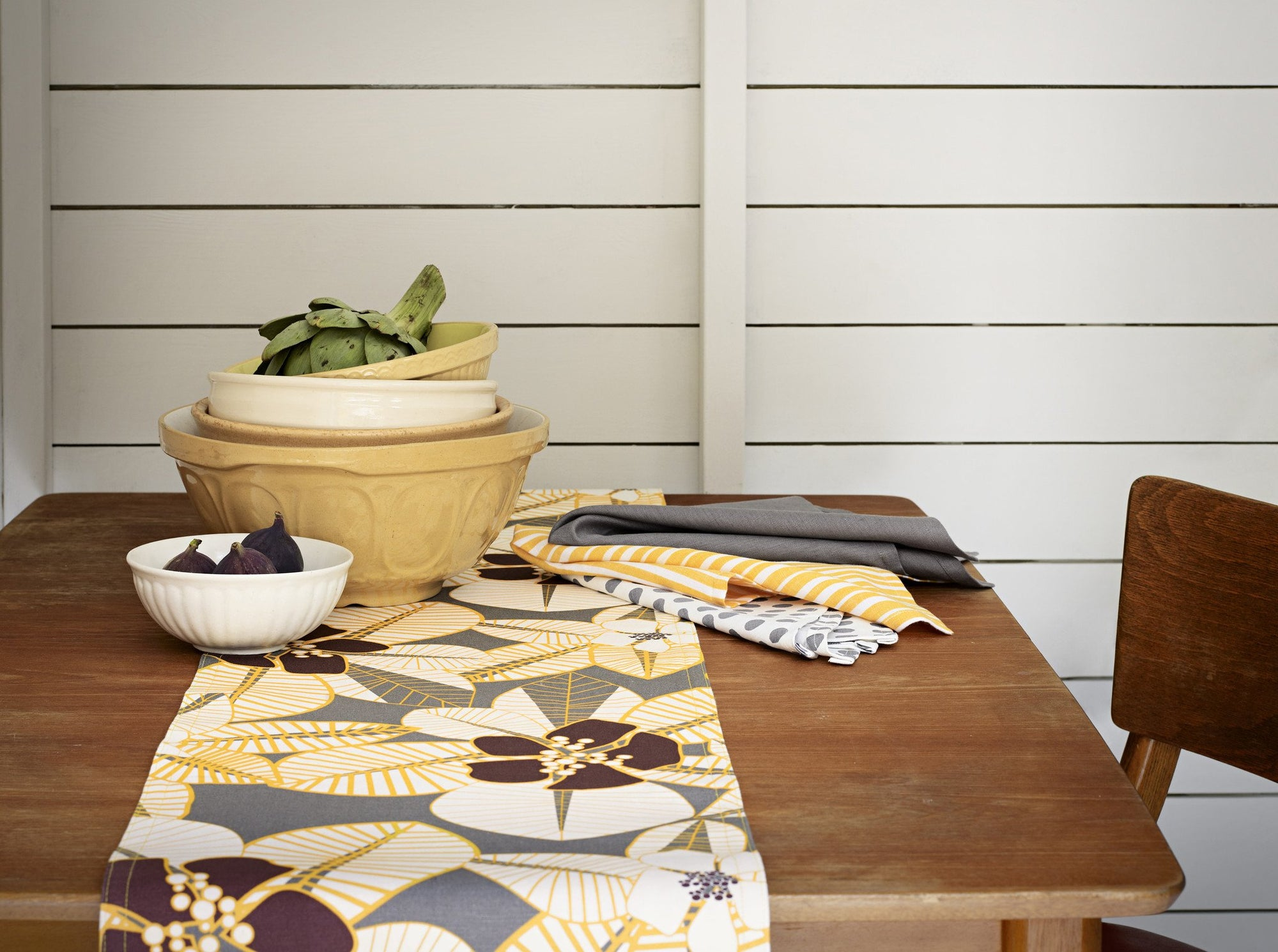 Cotton linen tablecloths, napkins and table runners in bold, modern patterns and stripes in shades of yellow. Ships from Canada worldwide including the USA