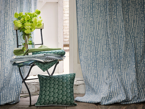 Hopi Fabric inChambray Blue made into curtains with Apple Tree Cushion in Moss Green