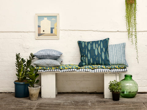Cushions in Chambray and Petrol Blue on seat covers made from Autumn Stripe in Petrol Blue and Eden Floral in Chartreuse Yellow