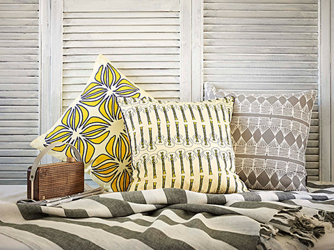 Nina and Ukelele Cushions in Straw Yellow with Palermo Stripe Cushion in Stone Grey