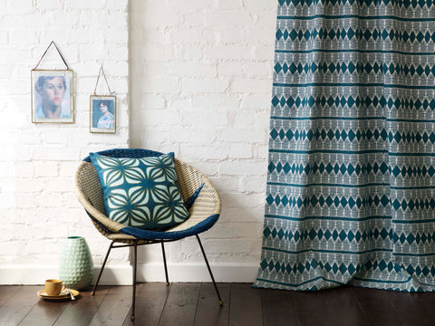 Huts Fabric in Petrol Blue made into curtains and Nina cushion in Petrol Blue