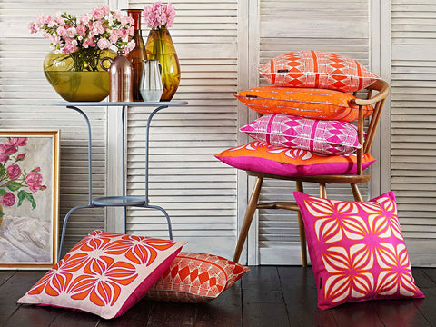 Huts and Nina Cushions in Pumpkin Orange and Fuchsia Pink