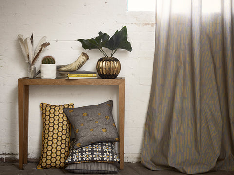 Rosemary fabric in Dove Grey and Saffron Yellow with Leopard, Fruit and Dorothy Cushions in Grey and Saffron